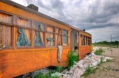 Old Abandoned Railway Car. An Orange Rusty Old Abandoned Railway Car stock photo