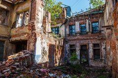 Old abandoned red brick house ruin, damaged by earthquake, war or other natural disaster, demolished decay debris Royalty Free Stock Images