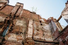 Old abandoned red brick house ruin, damaged by earthquake, war or other natural disaster, demolished decay debris Stock Photography