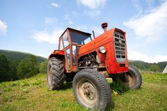 Old abandoned red tractor Royalty Free Stock Image