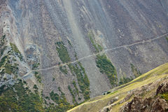 Old abandoned road along a steep hillside with rocky scree Royalty Free Stock Photography