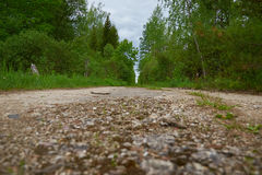 Old abandoned road disappears in distance Royalty Free Stock Photo