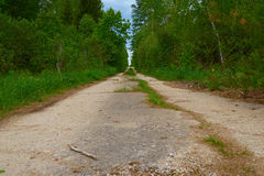 Old abandoned road disappears in distance Stock Image