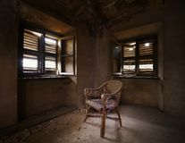 Old abandoned room with chair Royalty Free Stock Photo