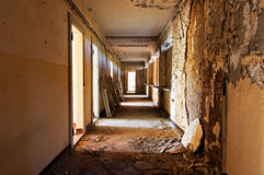 Old  abandoned room and corridor of a building Royalty Free Stock Images