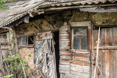 Old abandoned rotting house in the village Stock Photo