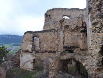 Old abandoned ruin of a castle covered with vegetation Royalty Free Stock Photography
