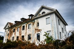 Old abandoned ruined and destroyed building stock photo