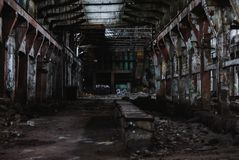 Old abandoned ruined factory, inner large hall Royalty Free Stock Photo