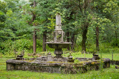 Free Old Abandoned Ruined Fountain In Overgrown Park Royalty Free Stock Image - 97920776