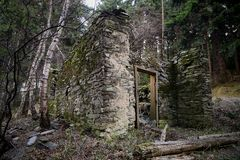Old abandoned ruined stone house. In mountains in the middle of the forest Stock Images