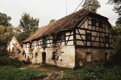 Old abandoned rural house in polish village royalty free stock photo