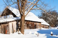Old abandoned rural house in sunny winter day. Old abandoned typical russian rural house in sunny winter day in little village in Smolensk region of Russia Royalty Free Stock Photo