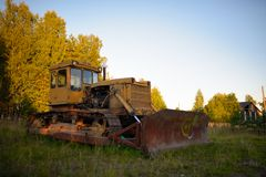Old abandoned Russian rusty tractor Stock Photo