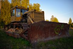 Old abandoned Russian rusty tractor Stock Image