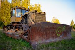 Old abandoned Russian rusty tractor Stock Photography