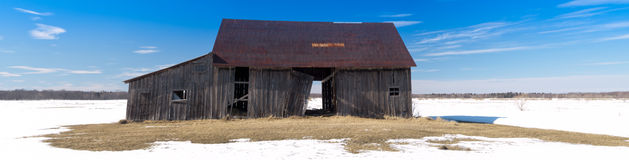 Old abandoned rusted barn Stock Photo