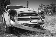 Old abandoned rusted car, closeup photo Royalty Free Stock Images