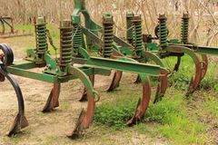 Old abandoned and rusted plow machinery. In the countryside Stock Photos