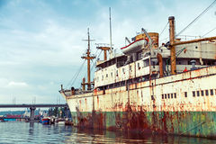 Old abandoned rusted ship stands moored in Varna Stock Images