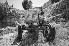 Old abandoned rusted tractor stands Royalty Free Stock Photo