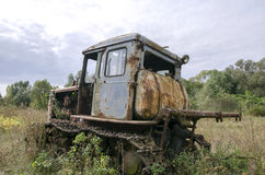 Old abandoned rusted tractor Stock Image