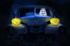 Old abandoned rustic car with ghost. And pumpkins. Halloween concept royalty free illustration