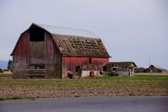 Old abandoned rustic wooden barn. Royalty Free Stock Image