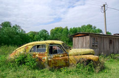 Old abandoned rustic yellow car. In summer Royalty Free Stock Images
