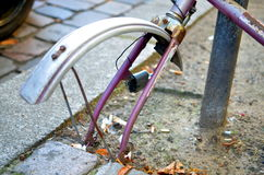 Old abandoned rusty and broken bike at the street Royalty Free Stock Image