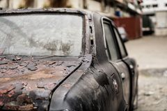 Old Abandoned Rusty Car. At the back alley Royalty Free Stock Image