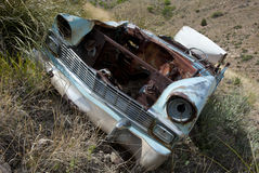Old abandoned rusty car. Old abandoned car on hillside in American desert Royalty Free Stock Photography