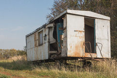 Old abandoned rusty construction in rural Russian countryside field Stock Photo