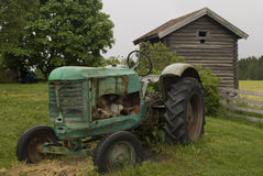 Old abandoned rusty tractor. Stock Images