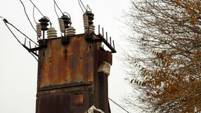 Old abandoned rusty transformer station stock photography