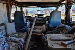 Old abandoned RV with broken windshield royalty free stock image