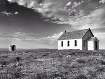 Old abandoned school house on the prairie. Stock Photos