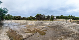 Old abandoned school sports court or schoolyard for different ac Stock Photo