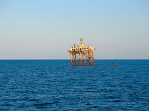 Old abandoned sea rusty drilling platform Royalty Free Stock Photo