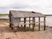 An old and abandoned sea shack shed decaying and rotting Royalty Free Stock Photo