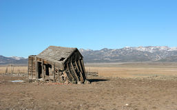 Old abandoned shack. An old dilapidated shack sits in an empty field Stock Images