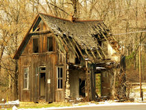 Old Abandoned Shack. This is a photo of a long-abandoned house that once stood along the railroad tracks in central Pennsylvania. The railroad is long gone and Stock Photography