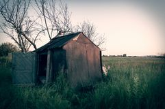 Old abandoned Shack. Film effect with vignette Stock Photo