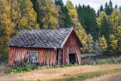 Old and abandoned shed. Abandoned shed with autumn colors at day time in Finland. Hyvinkää, Finland Royalty Free Stock Images