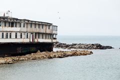 Old abandoned ship on the Black Sea coast in the Crimea.  Royalty Free Stock Photo
