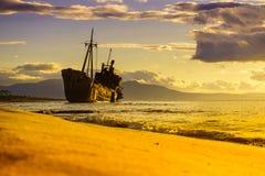 Rusty broken shipwreck on sea shore royalty free stock images