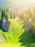 Old abandoned ski jump in Cortina d`Ampezzo - place of Winter Olympics in 1956 - in summer season. Dolomites, Italy.  Royalty Free Stock Image