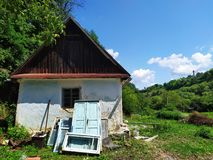 Old abandoned small house near the forest. royalty free stock photography