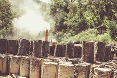 Old Abandoned Smoking Chemical Fuel Barrels Near Thimphu, Bhutan Royalty Free Stock Photo