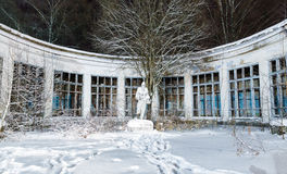 Old abandoned Soviet statue and building Stock Photo